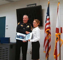 Left to right, Jacksonville Beach Police Chief Patrick Dooley; Georgette Dumont