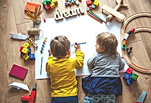 Kids drawing on floor on paper. Preschoo