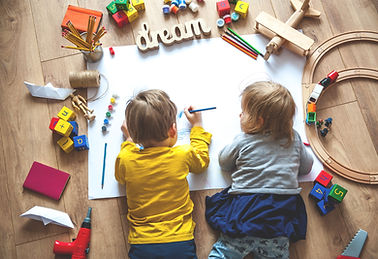 Kids drawing on floor on paper. Preschoo