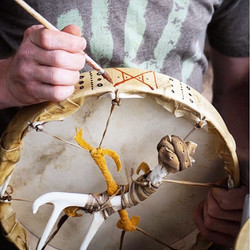 Decorating our drums with handmade natur