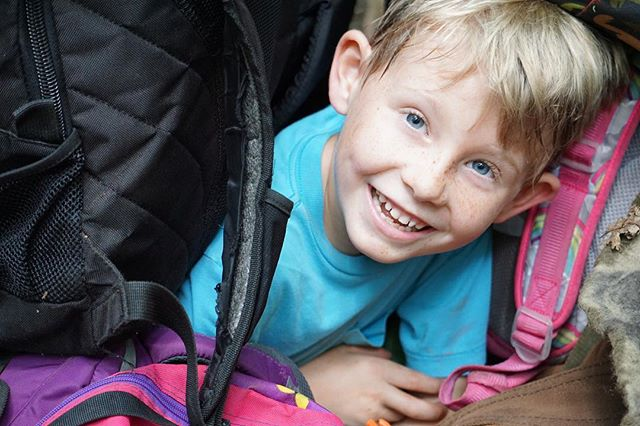 Piles of backpacks make the best hiding spots!