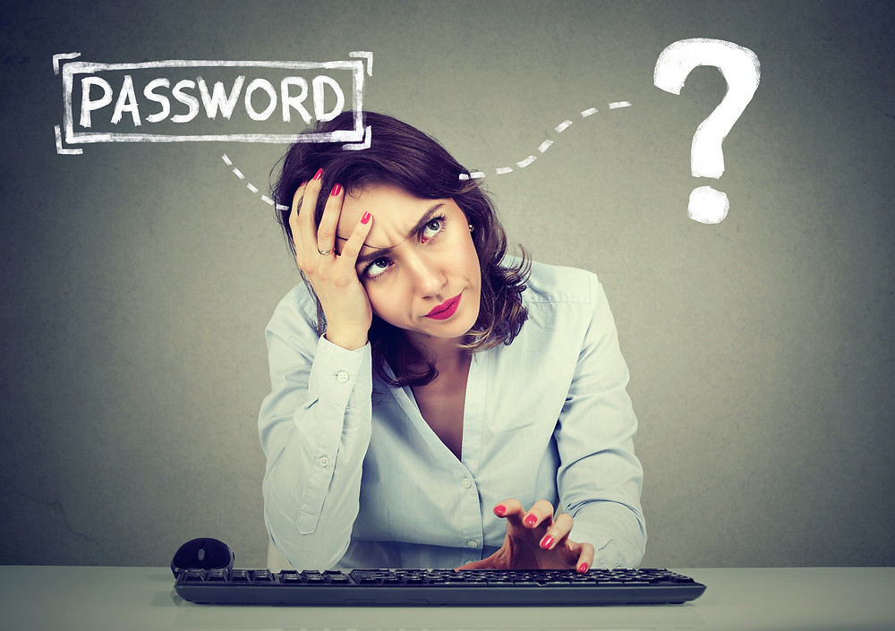 Woman thinking of a new password