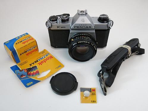PENTAX K1000 SLR film Camera with smc 50mm f 2.0 lens + film