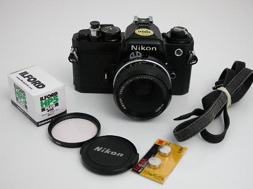 Nikon FE 35mm SLR film Black camera body + Nikon 50mm lens New Light Seals