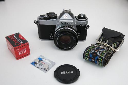 Pristine Nikon FE 35mm SLR Manual Film Camera + Nikon 50mm 1.8 +  new light seal