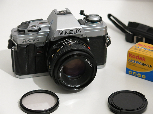 Minolta X-370 SLR film camera with 50mm 1.7 lens Mint Made in Japan