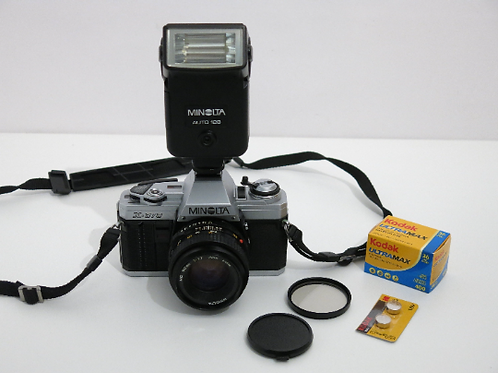 Minolta X-370 SLR film camera + 50mm 1.7 lens + film and AUTO 128 Flash