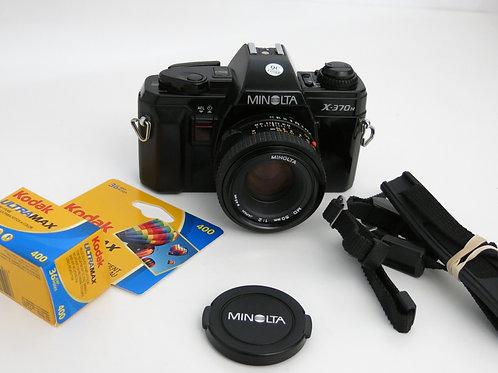Minolta X-370n Black with 50mm f:2 lens