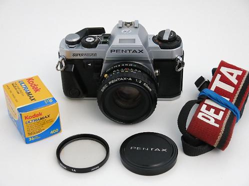 Pentax Super Program SLR Camera with 50mm f:2.0 lens New Light Seals Free Shippi