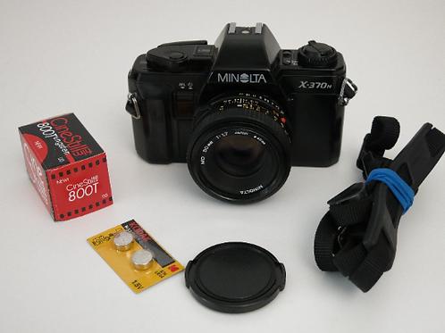 Minolta X-370n SLR film camera with 50mm f:1.7 lens + CineStill 800T film