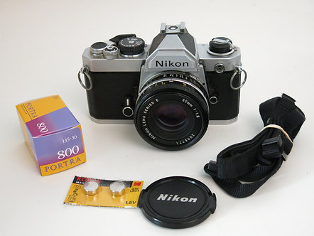 Nikon FM 35mm SLR professional film camera + 50mm 1.8 series E lens with