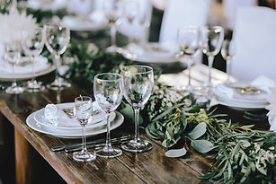 simple Wedding Table centerpiece Design with greenery and glassware raleigh downtown wedding