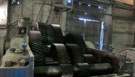 Трехступенчатый редуктор с косозубыми шевронными колесами
