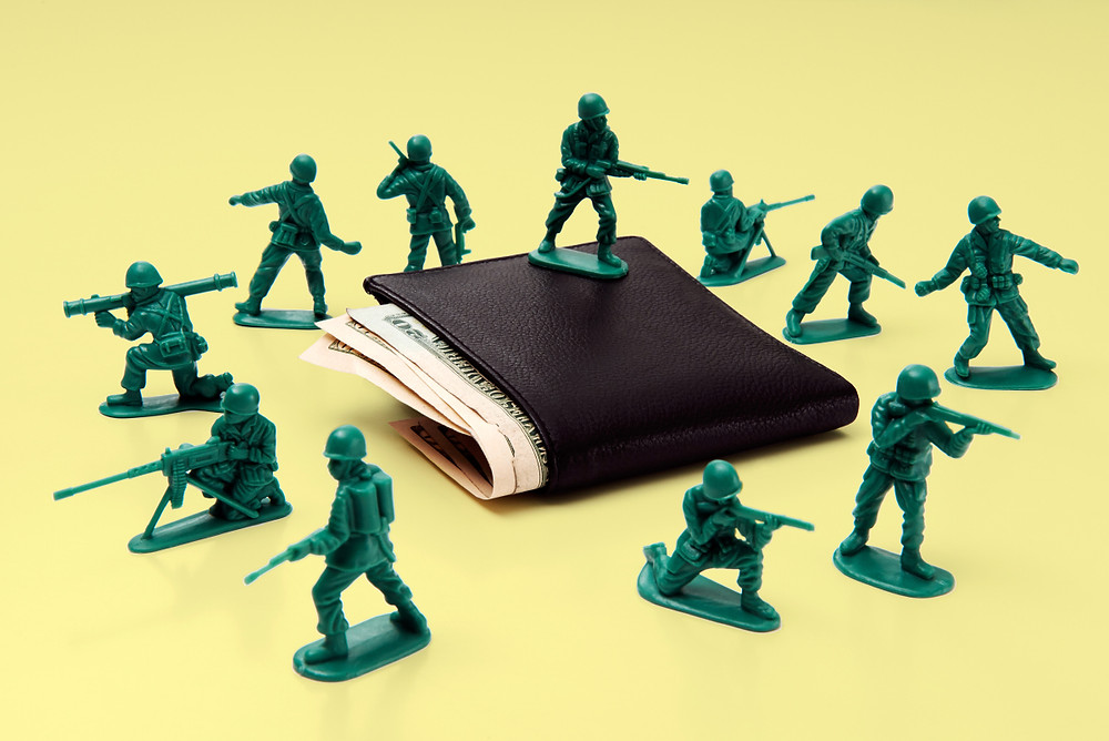toy soldiers protecting wallet