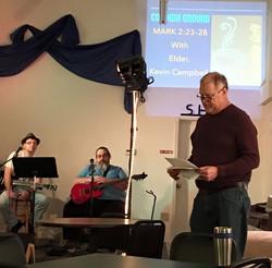 Elder leading worship