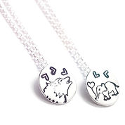 Wolf and elephant necklaces