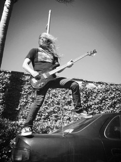 Slappin' the bass.