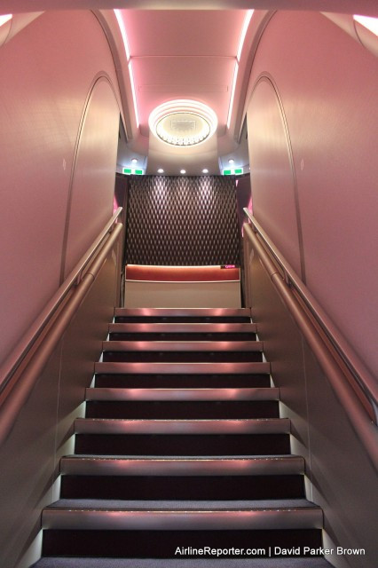 Up the forward stairs to the First Class cabin -- it is very welcomeing