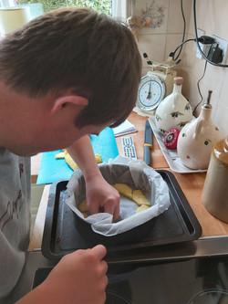 Tom making pineapple upside down cake
