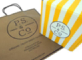 Custom printed P.S. & Co. shopping bags and hospitality packaging by Commonwealth Packaging Co.