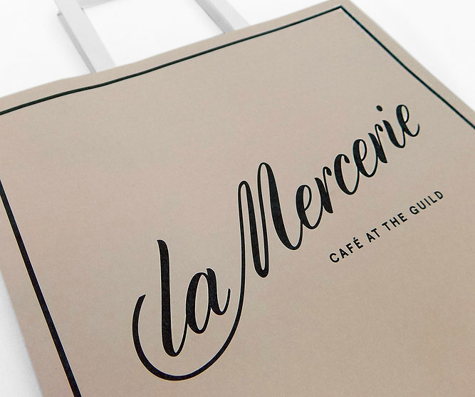 La Mercerie Custom printed hospitality packaging—takeout bag, cake boxes, pastry bags by Commonwealth Packaging Co.