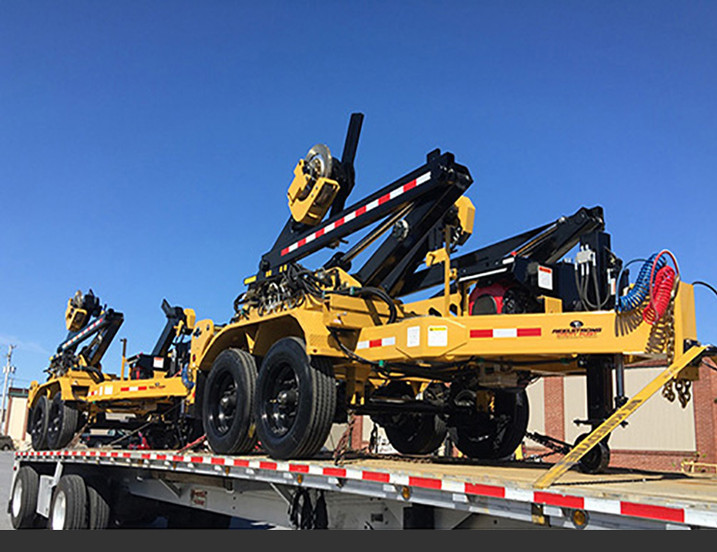 PINLESS/ ARBORLESS HEAVY HAUL SELF-LOADING TRAILER For Today's Increasingly Larger Reels