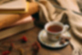 close-up-cup-tea-with-books_23-214831207