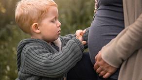 Babybauch- und Familienfotoshooting in einem.