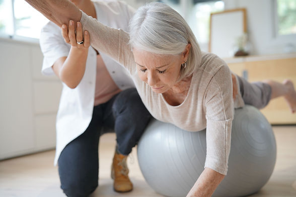 Senior woman exercising with her physiot