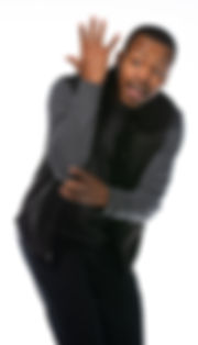 A photo of a young black man on a white back drop making a funny face in a theatre pose