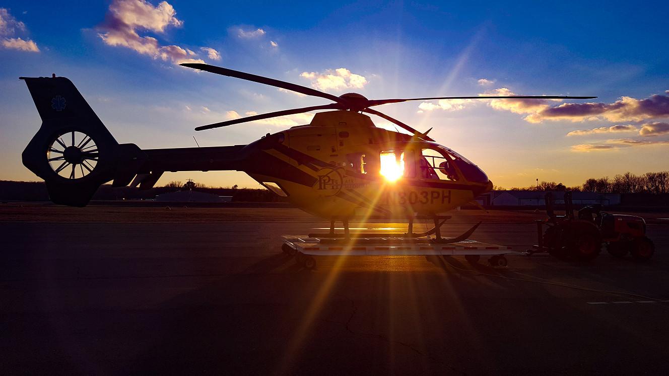 AIRCARE2 N303PH at sunset KEZF