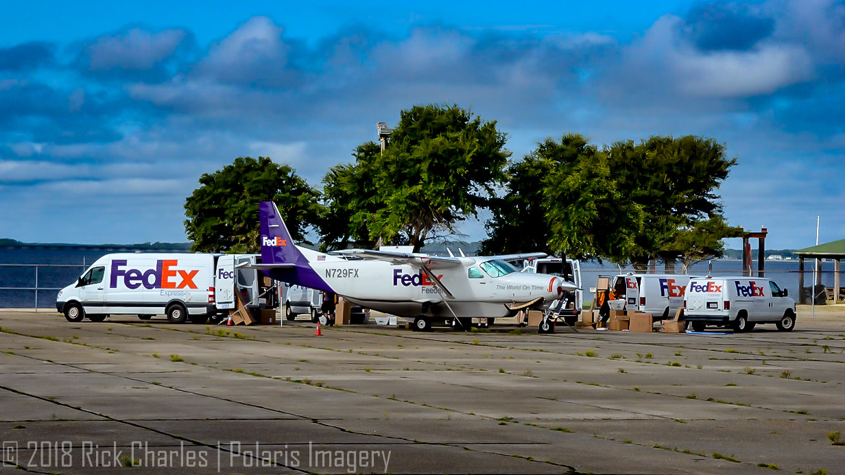 FedEx Feeder 208 unloads at KMQI