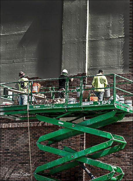 Crew bricking up building along Tampa Bay Harbor Tour, Tampa FL