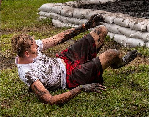 11 mud wars_man red shorts fall_FLT.jpg