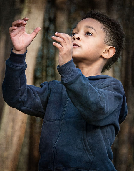 Future is in my hands, says boy reaching for football