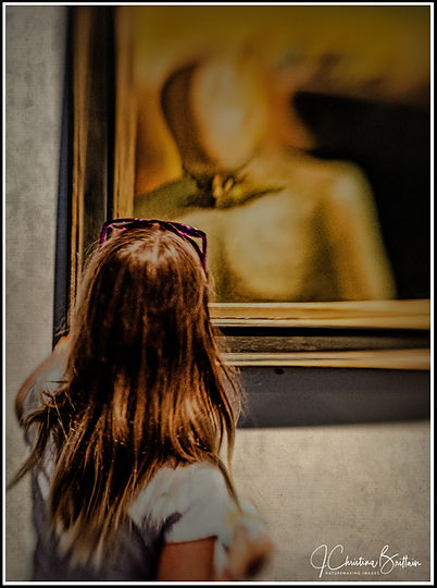 Young girl touched by the spirit of Ghandi at Dali Museum, St Petersburg, FL