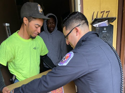 police man delivering package to family