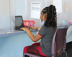 young girl at her laptop for virtual lea