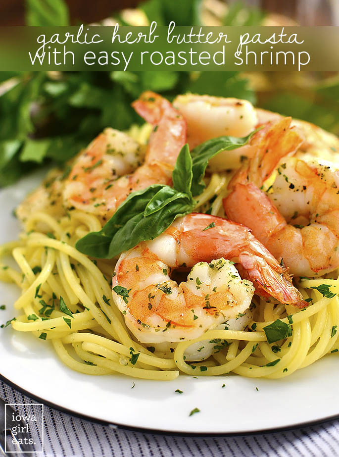 Plate of shrimp Scampi over pasta with chopped herbs and basil garnish