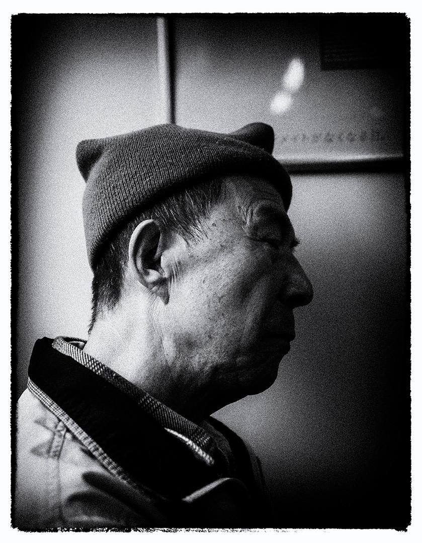 Man on metro, Tokyo Japan, November 2014