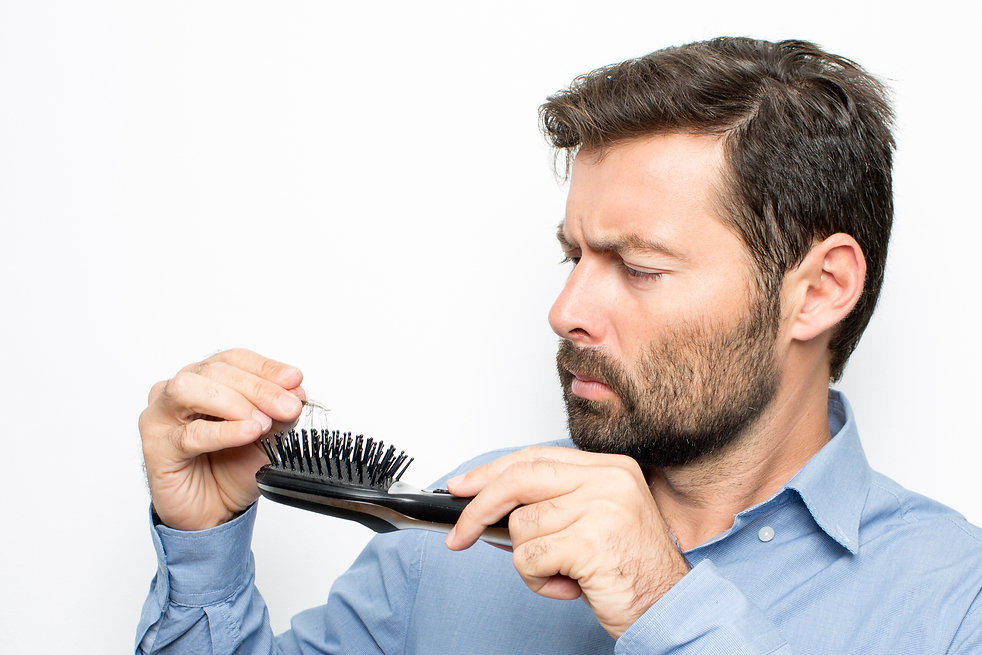 Men w comb - hairloss.jpg