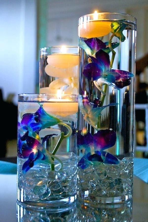Cylinder Vases with submerged orchids and floating candles / Image courtesy of Aaron Joseph