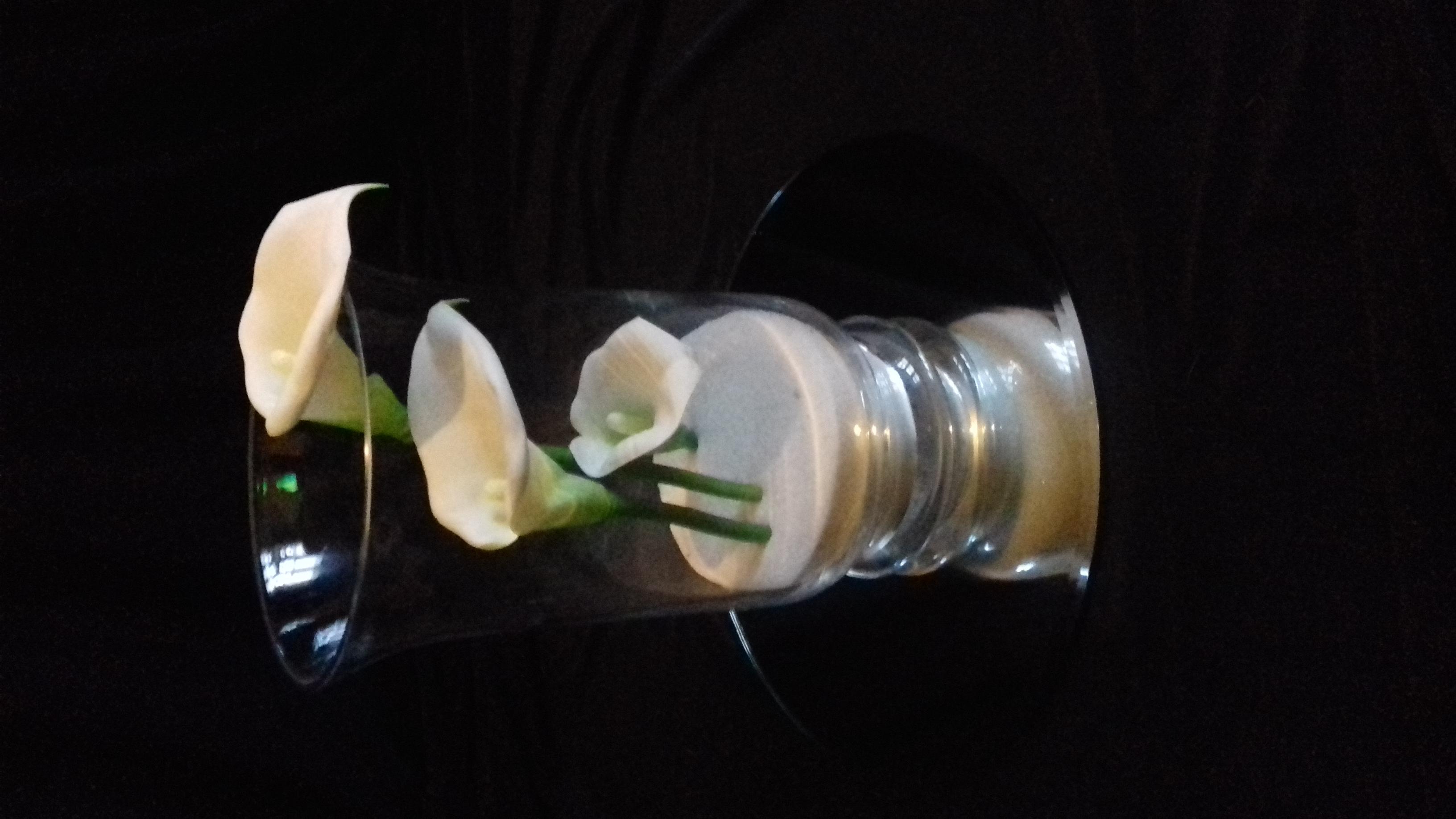 Calla lilies in hurricane vase