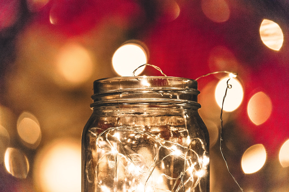 Glass Jar containing Micro Lights / Image courtesy of Nong Vang - Unsplash