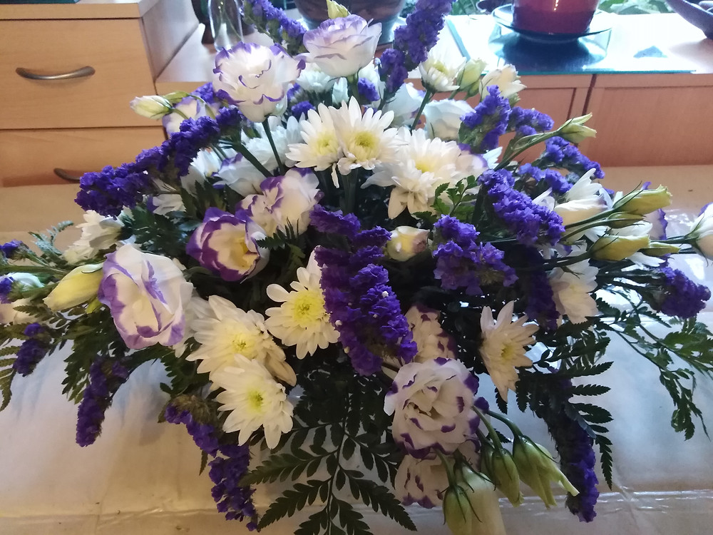 PC Creations Leeds Purple and ivory floral arrangement using purple statice