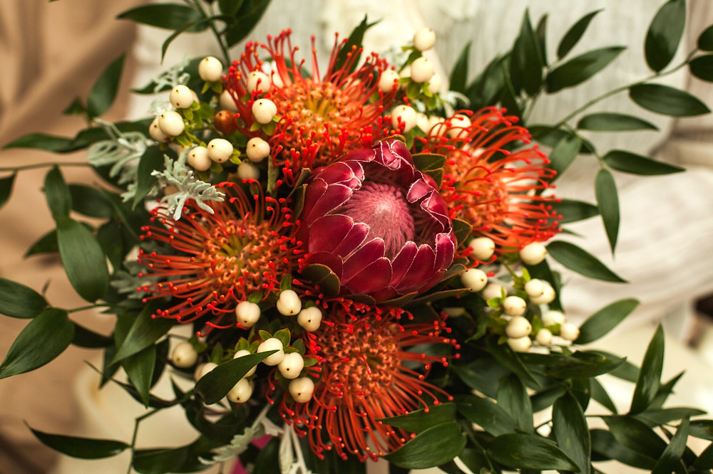 Bouquet by PC Creations Leeds / Ivory hypericum berries combined with protea and leucospermum flowers