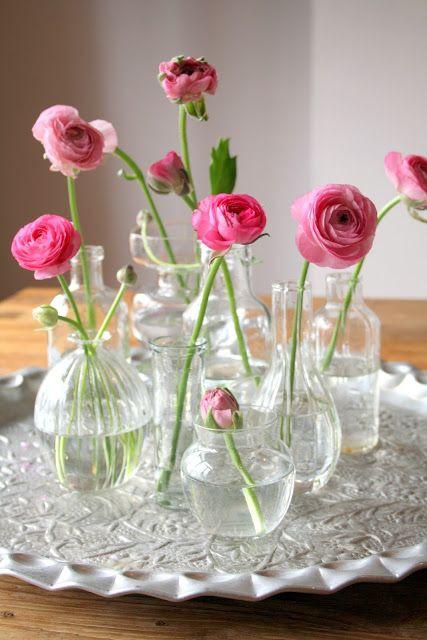 Ranunculus in stem vases centrepiece / image found on Pinterest