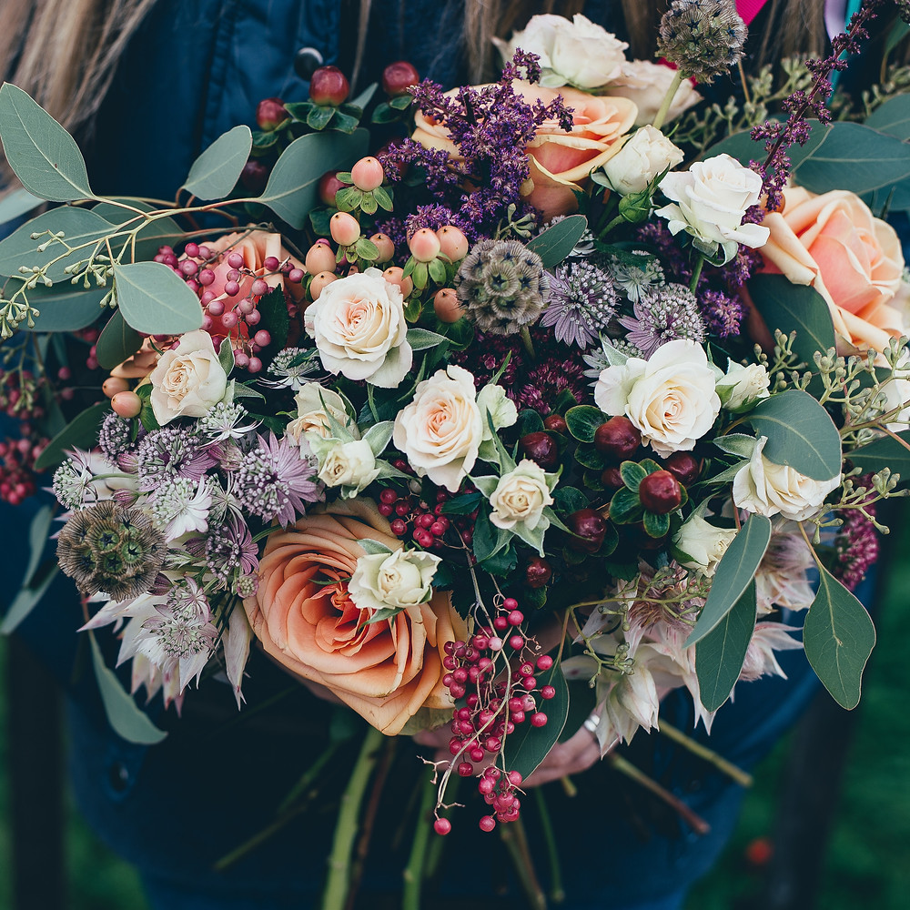 Brides Bouquet with berries, seeded eucalyptus and scabiosa seed heads.