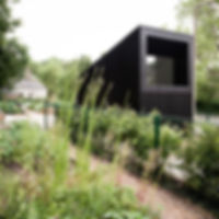 mackenzie place india allotments cabin shed garden edinburgh sutherland hussey harris black timber wood folding doors patio terrace decking meeting room