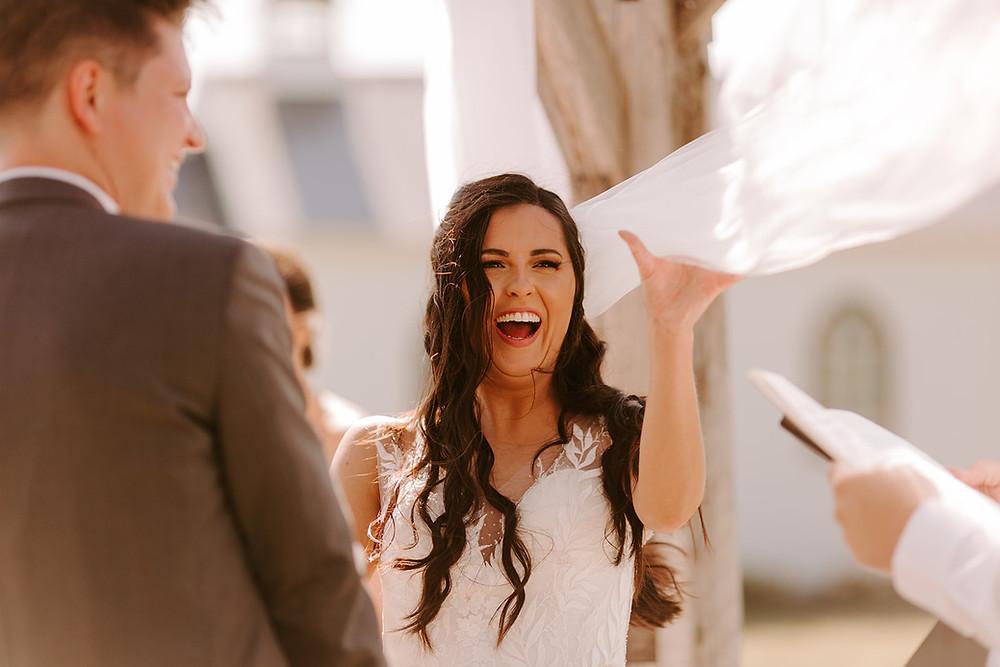 Wind guest blows a Bride's veil